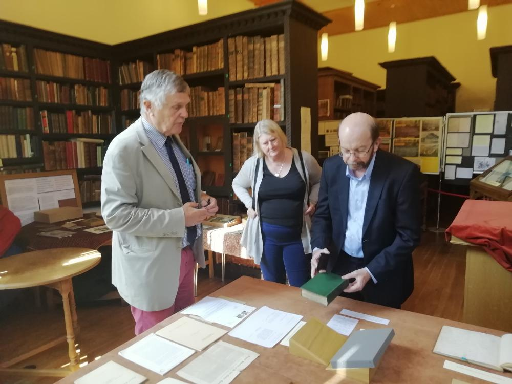 Vice Chancellor Simon Maddocks of Charles Darwin University views a first edition of Darwin's On the Origins of Species