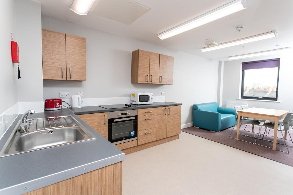A shared kitchen and living area in the Tannery